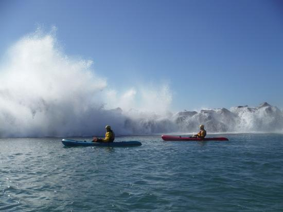 Central Coast Kayaks: ride along the break wall and wait for the big waves to crash