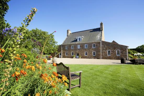 St. Mary, UK: Manicured gardens alongside the 18th century farmhouse
