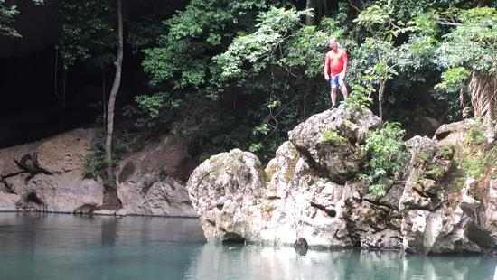 Ian Anderson's Caves Branch Jungle Lodge: Jumping into the lagoon during our lunch break on the cave tubing adventure
