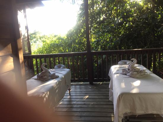 Ian Anderson's Caves Branch Jungle Lodge: Tables set up for our couples massage on our deck