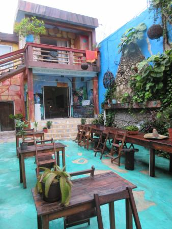 Mama's Home: Hostel courtyard with colourful murals