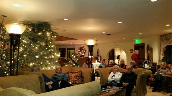Enzian Inn Guests Gather To Sing Christmas Carols Around The Piano