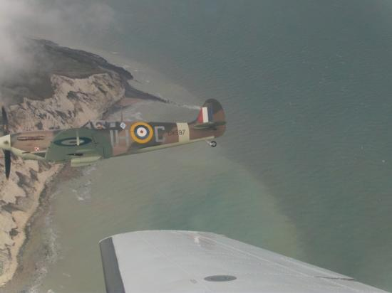 New Romney, UK: Action Stations Spitfire over Beachy Head. Paul Davies