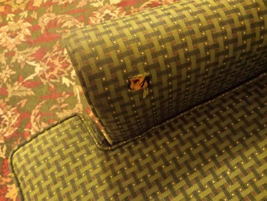 Inn at Reading: Burn hole in chair in lounge