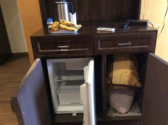 Non working referigerator and dirty linen stored in mini bar ...