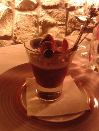 Strawberry cappuccino with vanilla ice cream, walnuts, meringue and forest berries