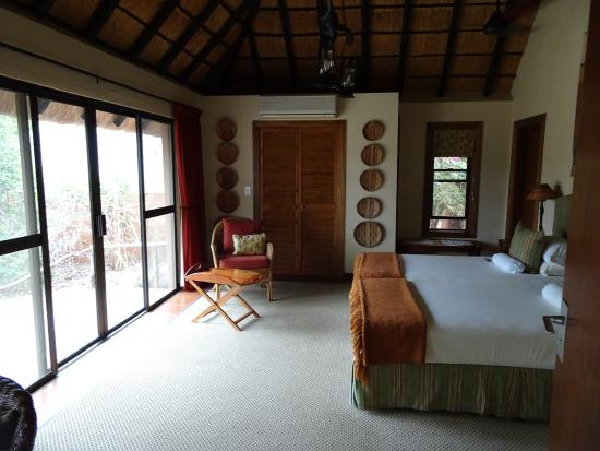 MalaMala Sable Camp: bed room, patio door opens