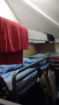 Bath Backpackers Hostel: between the low low beams and all the washing hanging on them its hard to move and is smelly
