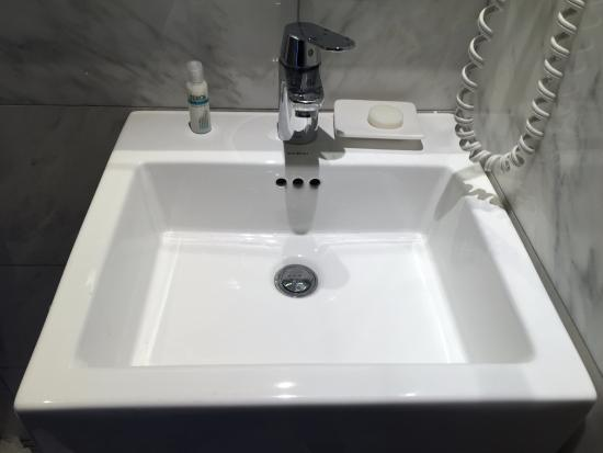 Bathroom Sinks Nyc bathroom sink. no counter space for toiletries. - picture of the