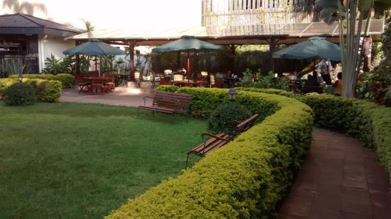 Garden and outside restaurant picture of jacaranda for Pool garden restaurant nairobi