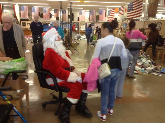 santa giving out toys to over 200 kids - Picture of