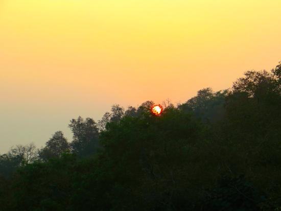 Haryana, India: sun sets behind the hills