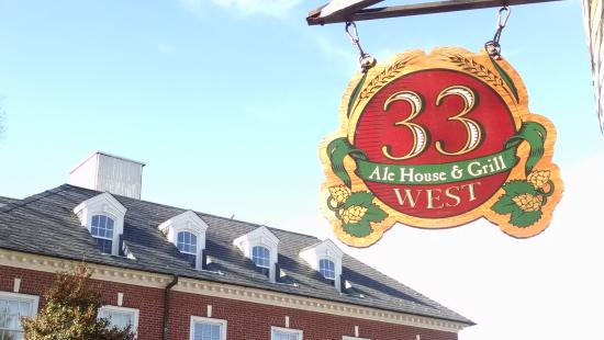 33 West Ale House and Grill: The front sign -- beautiful day and local architecture, right?
