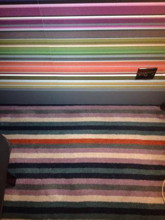 Village Hotel Coventry: Where does the carpet end and the wall begin?