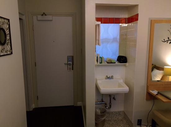 Touchstone Hotel - City Center: Sink is outside of the bathroom.  Nice soap & shampoo..