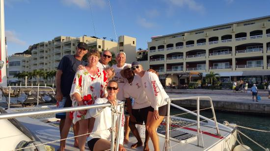 Simpson Bay, St. Maarten-St. Martin: Captain John, the crew and the six of us. What a great day!