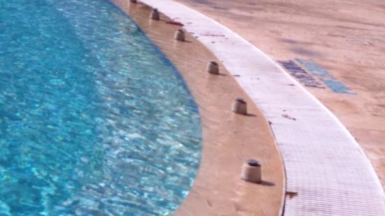 piezas metlicas oxidadas al borde piscina de nios Picture of