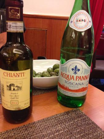 Panefformaggio: cheap yet delicious sweet red wine, and uncarbonated/flat water