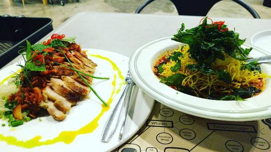 """The Concept """"Aromatic Thai Cuisine"""": Pomelo and pork salad on the left (spicy), and Australian beef red curry on the right"""