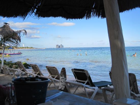 Chiquita: Bucket of beer and ocean view toward cruise ships