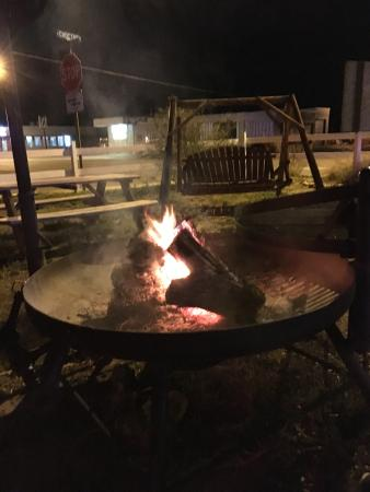 Blue Swallow Motel: community fire pit, swing, and seating