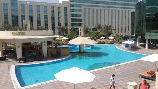 Pool picture of millennium airport hotel dubai dubai tripadvisor for Dubai airport swimming pool price