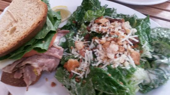 Dancing Goat Cafe & Bakery: Half roast beef sandwich with side Caesar salad.