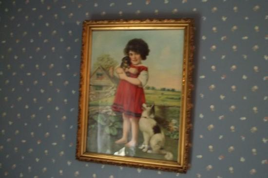 Jackson, MO: A very old picture of a child with her pets in the children's bedroom