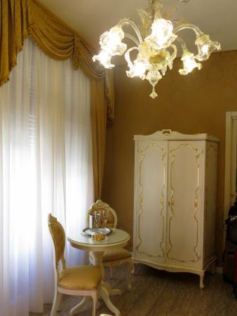 Sitting area of room, with Murano glass chandelier