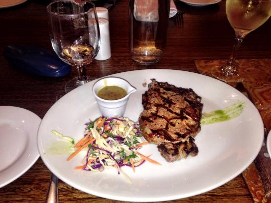 Steakhouse 66: Porterhouse Steak Medium Rare with Pepper Sauce