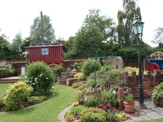 Bishops Lydeard mill: The beautiful front garden with gypsy caravan.