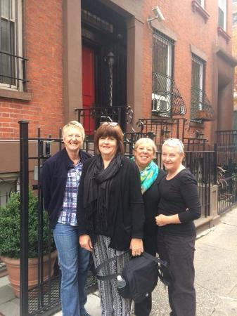 4 gals outside the East Village Apartments