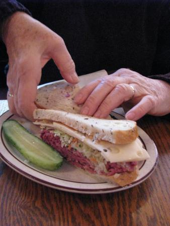 Sam LaGrassa's: corned beef, pastrami and swiss on rye, with cole slaw