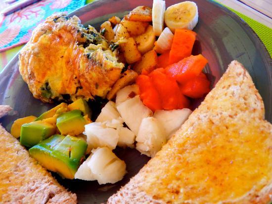 Little Bay, Jamaica: omelet potatoes papaya, banana, white pineapple, coconut bread