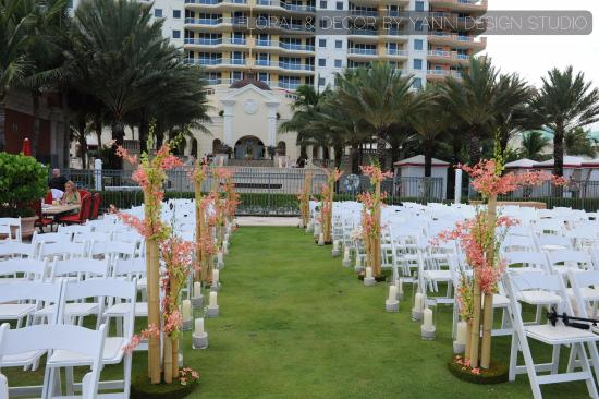 Acqualina Resort   Spa on the Beach  aisle ceremony decor for the Acqualina  resort Miami. acqualina resort miami wedding pictures featuring decor and floral