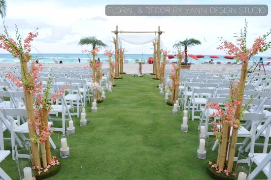 Acqualina Resort & Spa on the Beach: romantic marriage ceremony near the beach with bamboo decor.weddding took place at Acqualina Res
