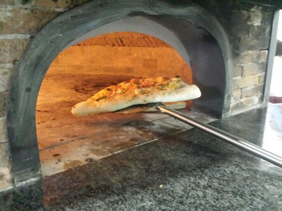Foto de restaurante italiano pizzeria los napolitanos - Horno de piedra ...