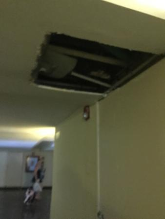 Grand Oasis Sens: Hole in ceiling in hallway in which water poured out leaving huge puddles on the floor
