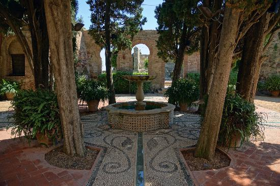 The fountain in the central patio, with the original fortress in the background.