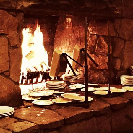fireside dining at empire canyon lodge restaurant raclette cheese fireplace