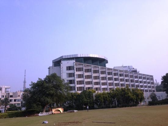 Ramada Plaza JHV: View of the hotel from the walking track beyond the swimming pool
