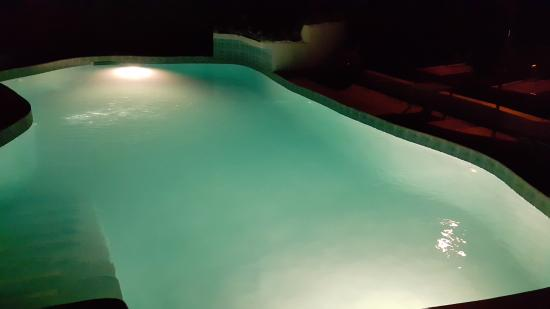 Blue Skies Apartments: Night time Pool