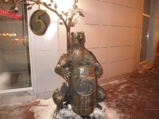 Sculpture of a Bear with a Barrel next to the Money Tree