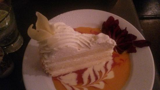 Extraordinary Desserts: Tres Leches on a beautiful mango sauce