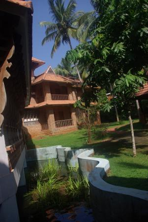 God's Own Country Resorts : View of the resort from the moat with fish around the reception area