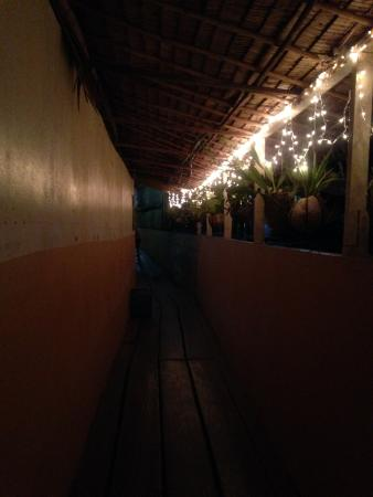 Patrik & Tezz Guesthouse: Christmas lights lighting up the wooden walkway to enter the accommodation