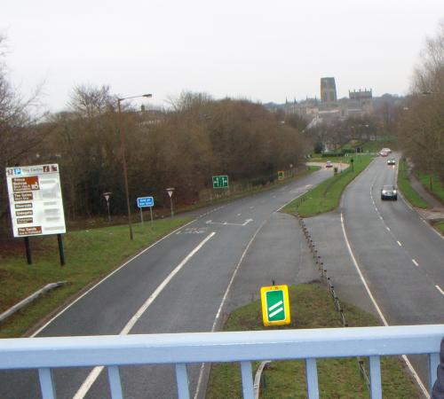 Travelodge Durham: Durham Cathedral from footbridge across A690 ... Travelodge situated behind trees to the left
