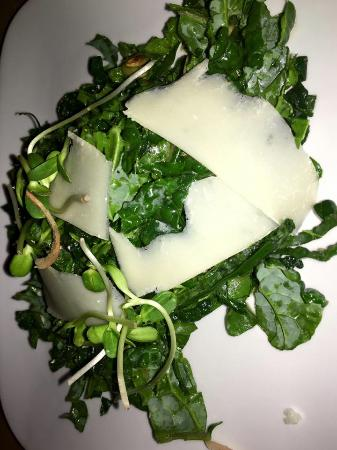 Revolution Kitchen: Lacinato kale salad with dried cranberries, toasted pumpkin seeds, Gran Padano, maple cider dres