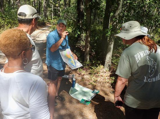 Shamong, NJ: Participants listent to Pine Barrens expert on a guided nature hike with Pinelands Adventures.
