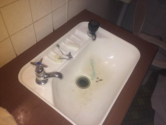 The Godley Hotel: Don't wash your hands in this sink if you value your life.